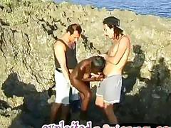 Homegrown African girl is having outdoor threesome with two guys